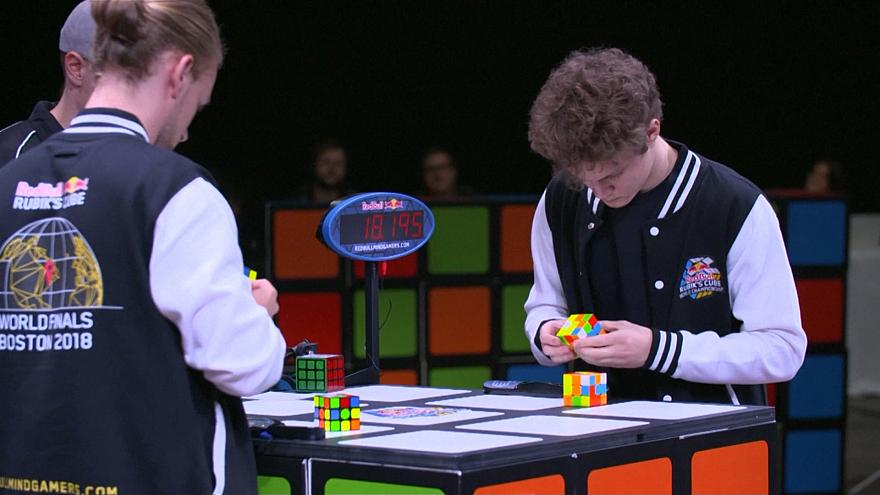 Watch: Speedy fingers compete in Rubik's Cube championship