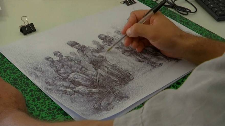 Exiled Syrian artist recreates his suffering in the country's prisons