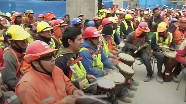 Construction workers use drums to de-stress in Chile