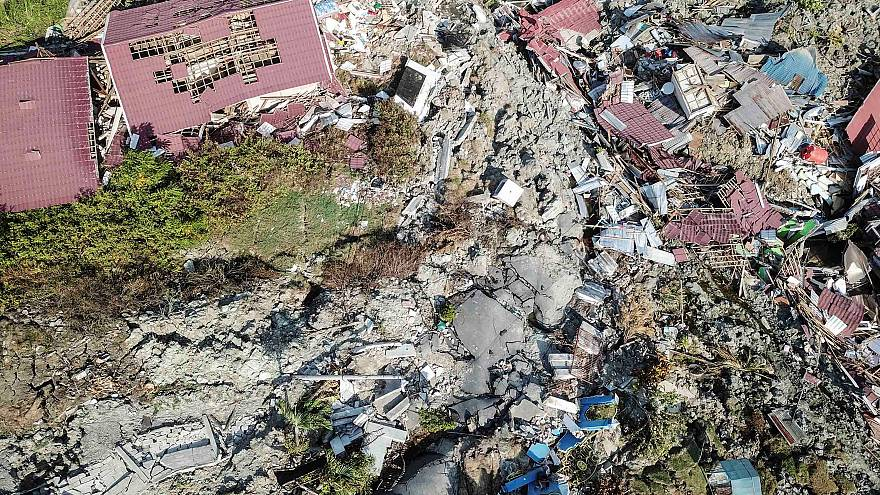 Desperate search continues as death toll rises after Indonesia earthquake