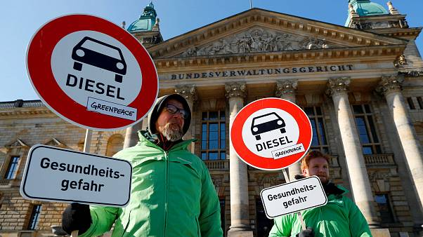 Greenpeace environmental activists protest in front of Leipzig court