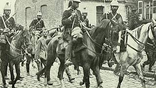 French cavalry marching German prisoners through the town of Aniche.