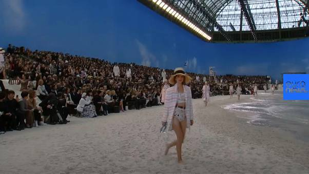 Catwalk turned into beach for Paris Fashion Week show