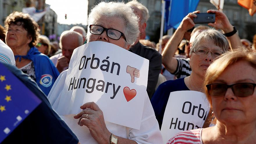 People attend a demonstration against Hungary's Prime Minister Viktor Orban