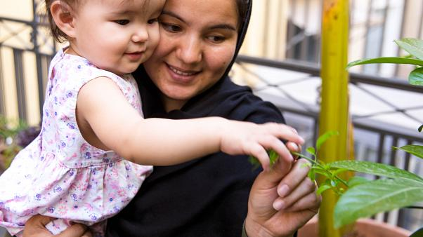 Soraya, 24, from Afghanistan with her daughter