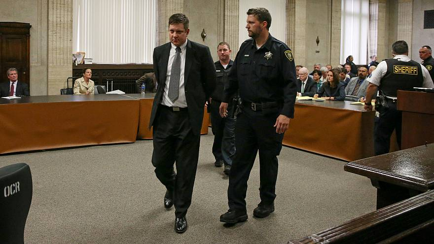 Chicago police Officer Jason Van Dyke is lead away after his guilty verdict