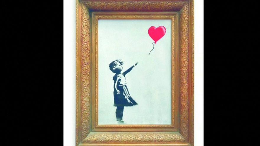 Banksy'nin 1,2 milyon euroluk tablosu satıldığı anda parçalara ayrıldı