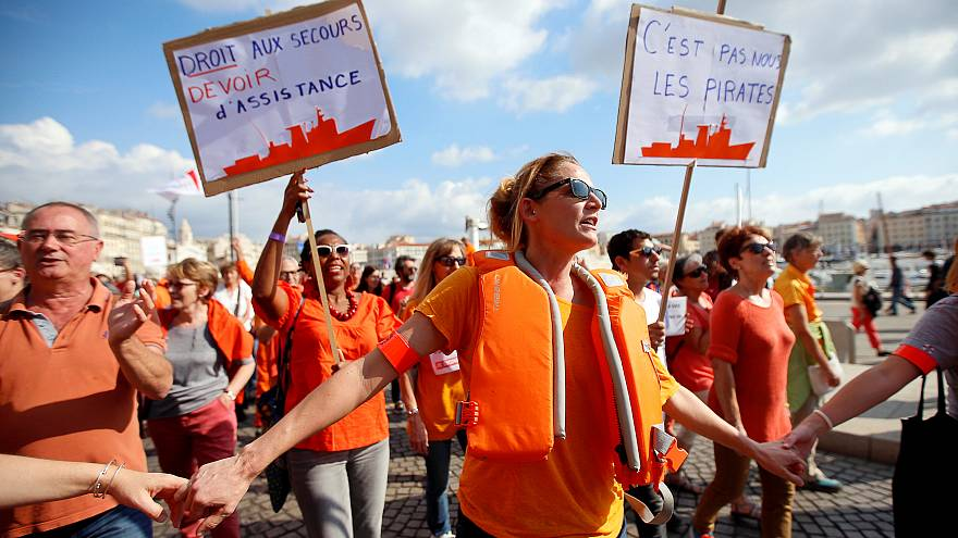 Thousands in France call for migrant rescue ship to be saved
