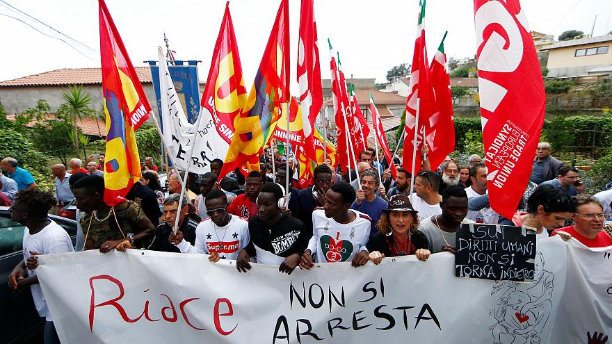 Migrants demonstrate in Riace to support mayor Lucano on October 6, 2018.