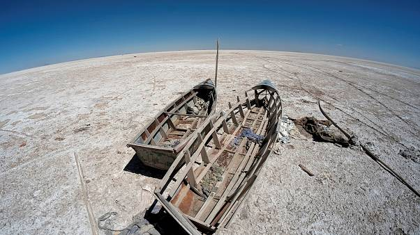Boats on the dried lake Poopo affected by climate change, in Bolivia.