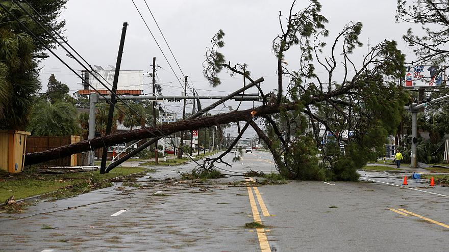 Hurricane Michael moves inland, leaving devastation behind