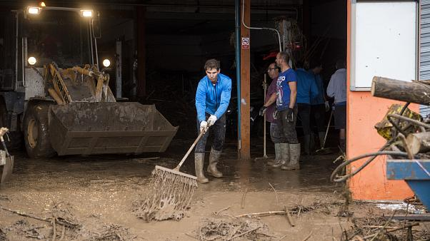 Rafael Nadal helps with the cleanup after floods in Mallorca