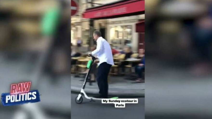 Donald Tusk tears through Paris on a scooter