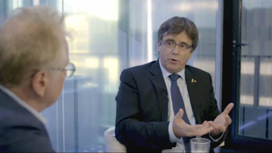 Stop treating Catalonia's separatists like criminals, exiled Puigdemont tells Euronews