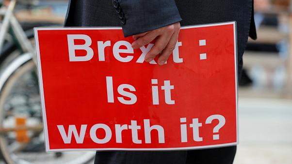 Protester holds placard during demonstration ahead of EU summit
