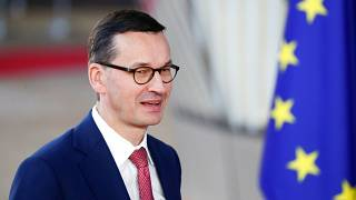 EU top court rules to freeze Poland's overhaul of Supreme Court