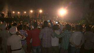 Train runs over crowd on tracks in northern India, 50 feared dead