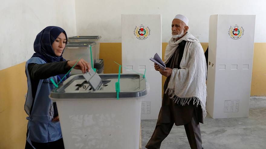 Afghans defy Taliban threats and vote in parliamentary elections