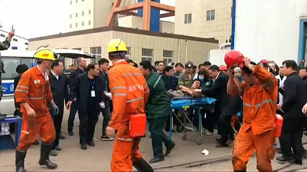 Two dead, 18 trapped in mine collapse in China