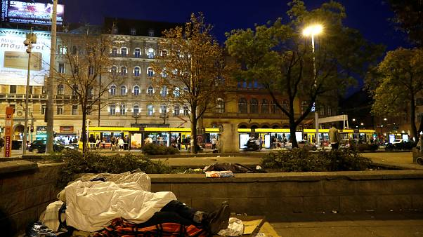 A homeless woman lies on the street in Budapest, Hungary, October 14, 2018.