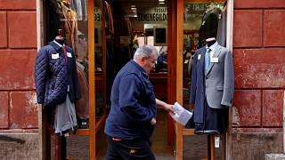 A man walks past a clothing shop in Rome, Italy October 22, 2018.