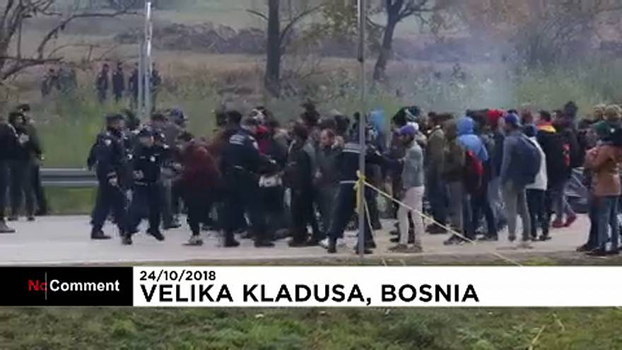 Migrants clash with Bosnian police while trying to cross the border into Croatia
