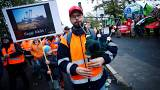 Employees of German utility RWE attend a labour protest, as environmentalis