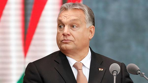 Orban supporters took buses 'bought with EU-funds' to watch his anti-EU speech in Budapest