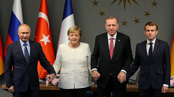 Macron, Merkel, Putin and Erdogan holding hands — an unlikely photo | Raw Politics