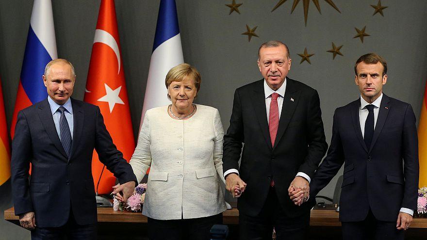 Macron, Merkel, Putin and Erdogan holding hands — an unlikely photo | Raw Politics