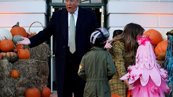 Donald and Melania Trump hand out Halloween sweets to children at White House