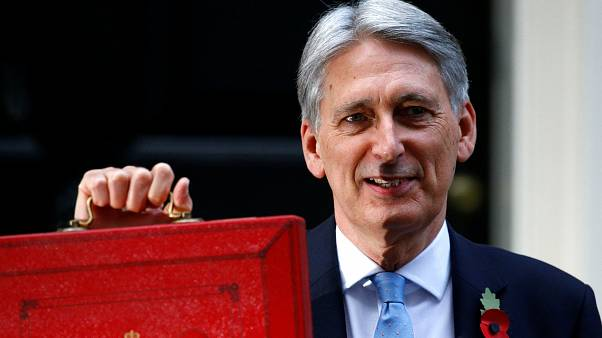 The UK Chancellor stands outside 11 Downing Street