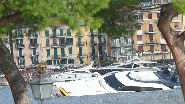 Semi-submerged yachts are seen in the harbour after windstorm and the stron