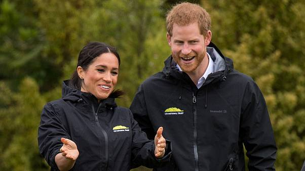 Harry and Meghan partake in NZ welly wanging competition