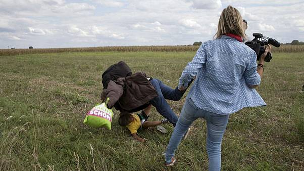 Hungarian court aquits camerawoman who tripped and kicked migrants