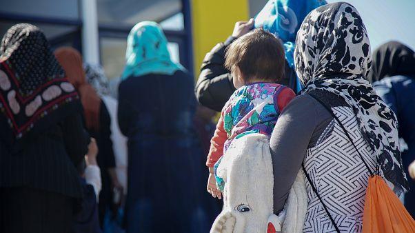 Refugee/migrant children & women enter the UNICEF-backed center in Moria