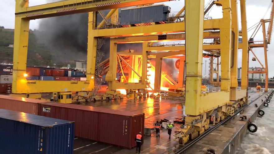 Fire breaks out after ferry collides with crane at Barcelona port