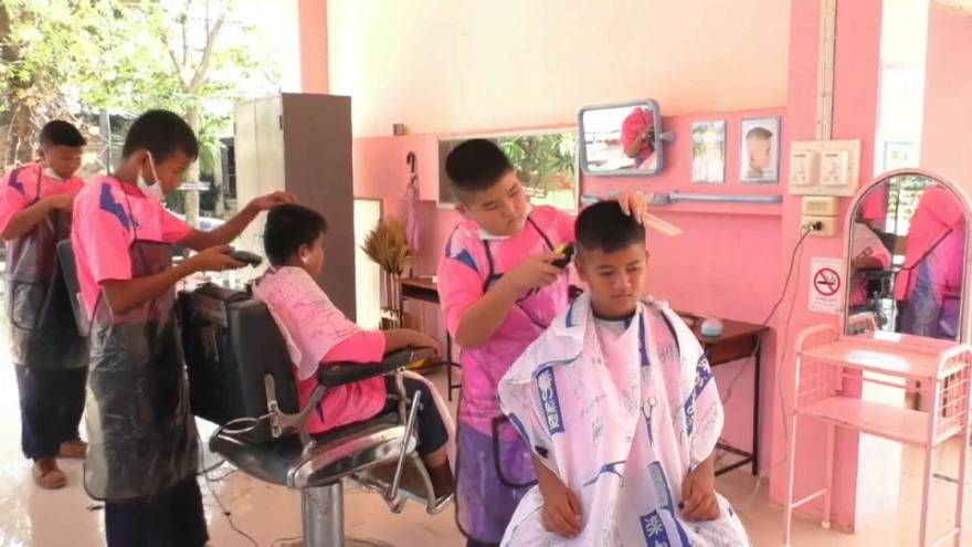 Child barbers offer haircuts at a snip in Thailand