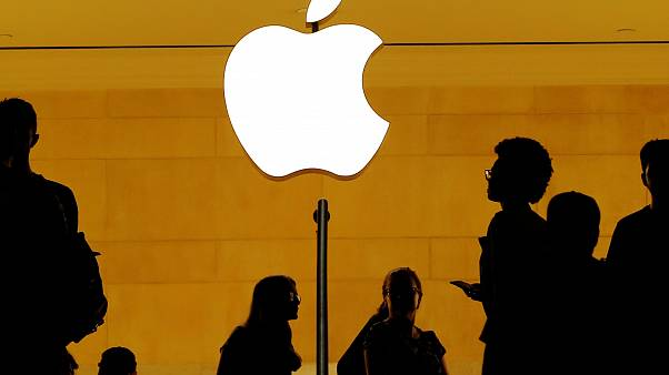 Apple sees clouds on horizon despite record results