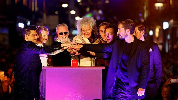 Queen's Brian May and Roger Taylor with the cast of Bohemian Rhapsody.