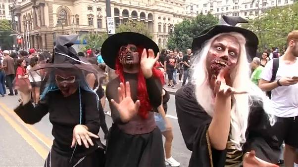 Zombies stagger through streets of Sao Paulo in annual parade