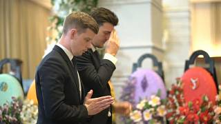 Leicester City players attend chairman's funeral in Bangkok