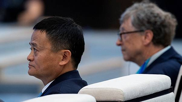 Microsoft founder Bill Gates (R) and Jack Ma, CEO of Alibaba