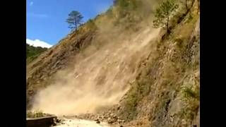 Watch: Trapped bus passenger films landslide in Philippines