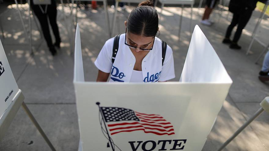 A voter makes her choice in the US midterm elections.