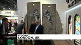Banksy Filistin'deki 'ayrım duvarı' üzerine çizdiği resmin kopyasını Londra'da sergiledi