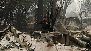 Death toll from California wildfires climbs to at least 23 people