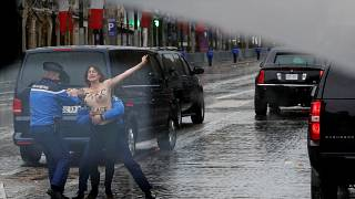 Topless protester gets within metres of Trump's motorcade in Paris