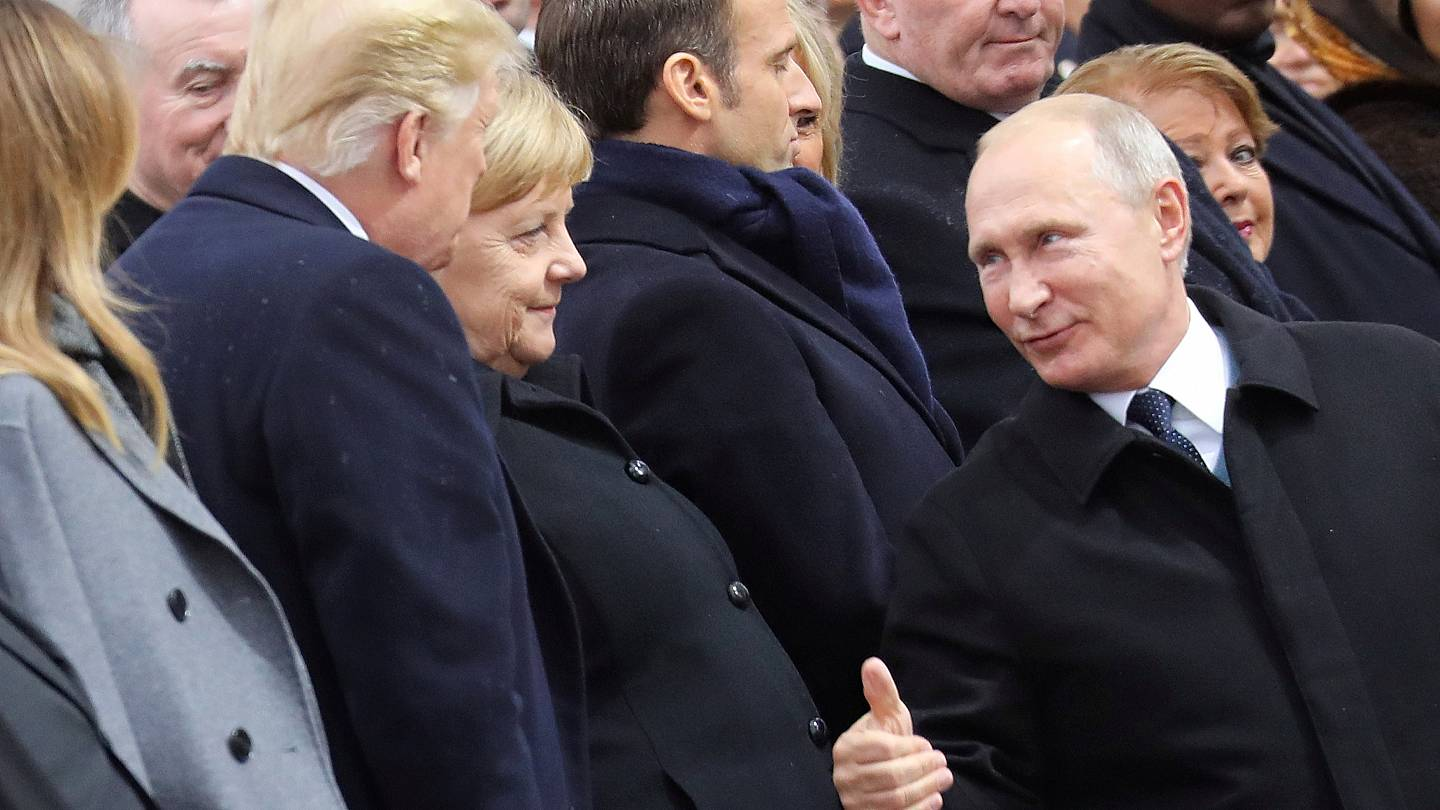 Watch: Putin's warm thumbs-up to Trump at Paris commemorations