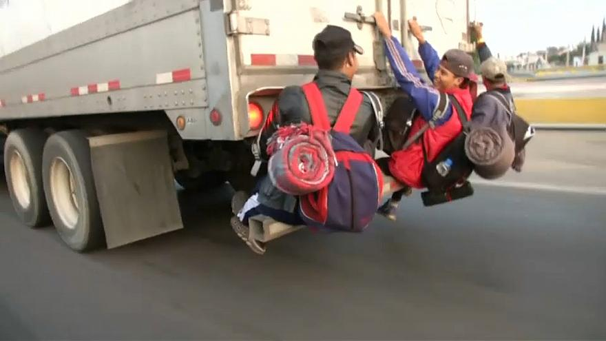Migrants scramble onto trailer in Mexico en route to northern border